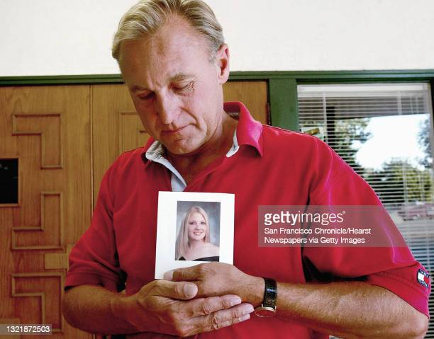 Monty Patterson holds a photograph of his daughter, Holly who died from complications after taking the abortion pill RU-486, at his home in...