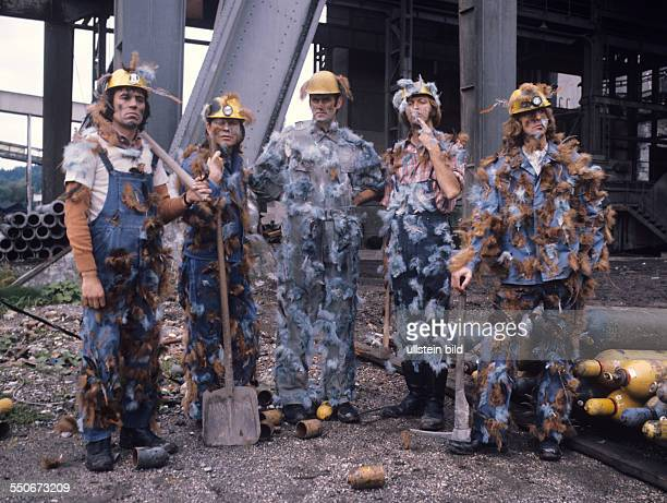 Monty Python's Flying Circus on a construction site with helmet and overall tarred and feathered from the l Terry Jones Michael Palin John Cleese...