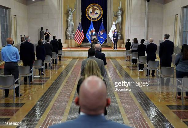 Monty Wilkinson, former acting U.S. Attorney general, introduces Merrick Garland, U.S. Attorney general, right, at the Department of Justice in...