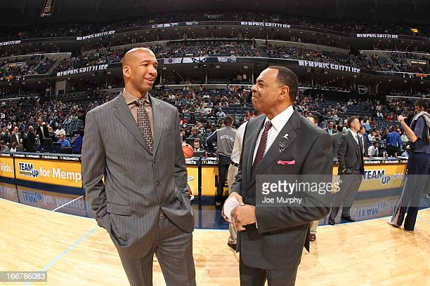 Monty Williams Head Coach of the New Orleans Hornets shares a word with Lionel Hollins Head Coach of the Memphis Grizzlies before their game on March...