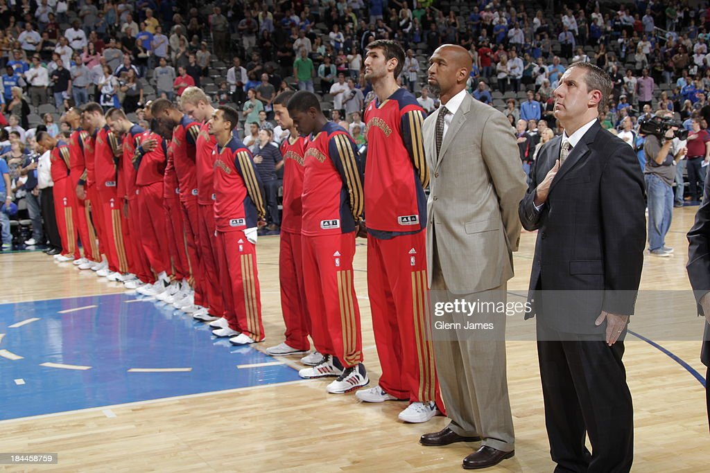 Monty Williams, head coach of the New Orleans Pelicans stands on the court before the game against the Dallas Mavericks on October 7, 2013 at the American Airlines Center in Dallas, Texas.