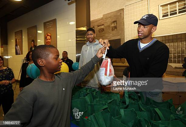 Monty Williams of the New Orleans Hornets distributes Thanksgiving baskets provided by the Hornets and Rouses to Emerge students on November 15 2012...