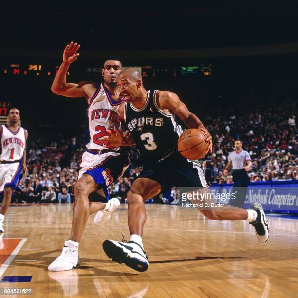 Monty Williams of the San Antonio Spurs drives against Allan Houston of the New York Knicks on March 31 1998 at Madison Square Garden in New York...
