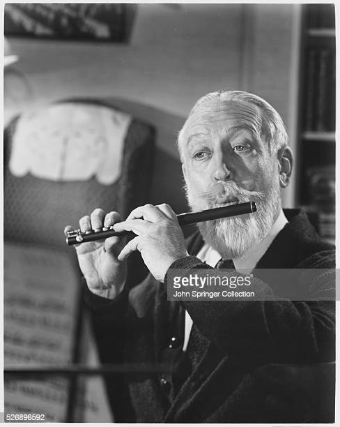 Monty Woolley as John R Hodges plays the piccolo in a scene from As Young as You Feel or Aussi Jeune que Vous Sensation The film is also known as...