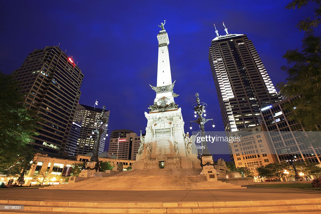 Monument Circle lit up at night in Indianapolis in Indiana : Stock Photo