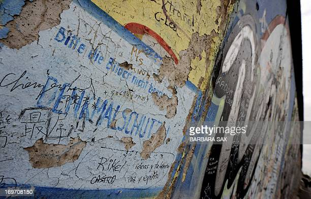 'Monument Conservation Please Don't damage' the Pictures' is written on a portion of the Berlin Wall on October 16 2008 at the East Side Gallery in...