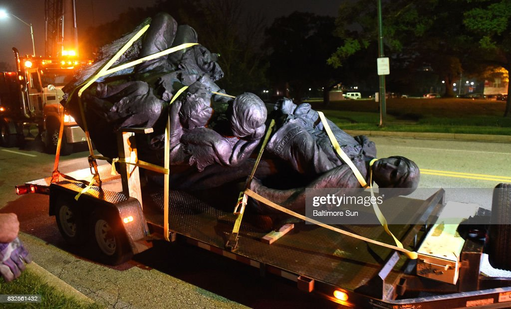 A monument dedicated to the Confederate Women of Maryland lies on a flatbed trailer near the intersection of Charles St. and University Parkway early Wednesday morning, Aug. 16, 2017 after it was taken down.
