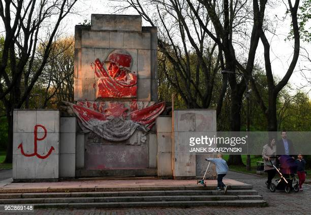 A monument from 1945 dedicated to Russian soldiers is partially covered with red paint in a park in Warsaw on April 20 2018 Nearly three decades...