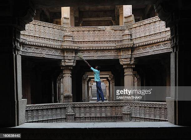 Monument Helper Vipulbhai cleans the 'AdalajNiVav' step well at Adalaj in Gandhinagar District some 30km from Ahmedabad on January 3 2011 Built in...
