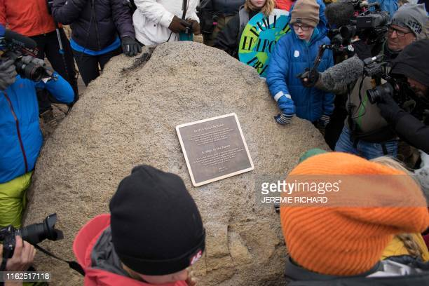 TOPSHOT A monument is unveiled at the site of Okjokull Iceland's first glacier lost to climate change in the west of Iceland on August 18 2019