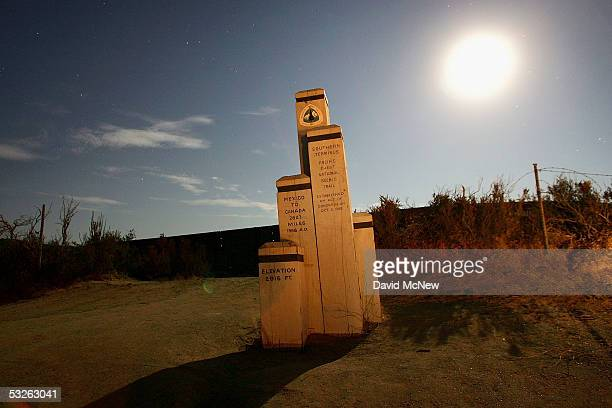 A monument marks the southern terminus of the Pacific Crest Trail which stretches from Canada to Mexico at the border where nightly patrols by...