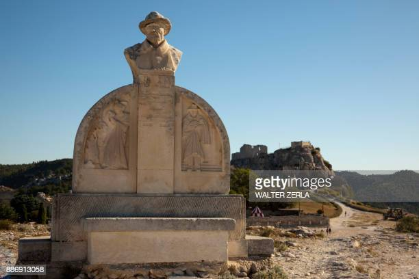 Monument of Charloun Rieu and view of distant town and castle, Les Baux-de-Provence, Provence-Alpes-Cte dAzur, France