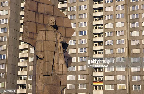 Monument of Lenin with residential building at the place of Lenin