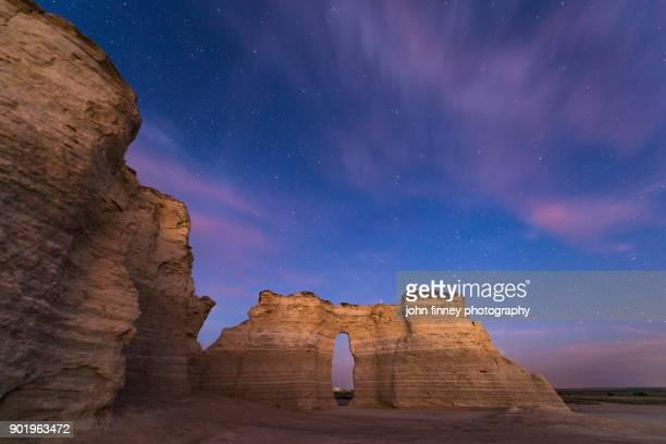Monument Rocks dusk with stars, Kansas, USA.