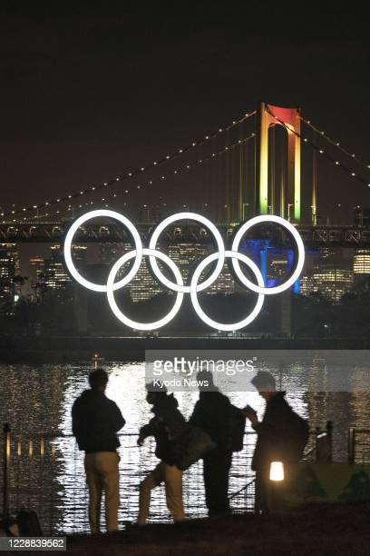 Monument showing the Olympic rings is lit up in Tokyo's Odaiba waterfront area on Jan. 24, 2020.