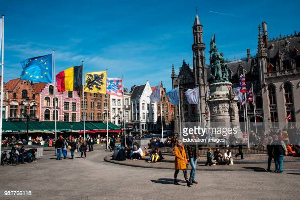 Monument to 1302 rebellion against the French in the market of Bruge Belgium