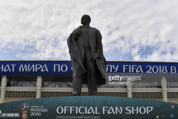 A monument to the Soviet Union founder Vladimir Lenin is pictured in front of the 80000seater Luzhniki Stadium in Moscow on June 12 ahead of the...