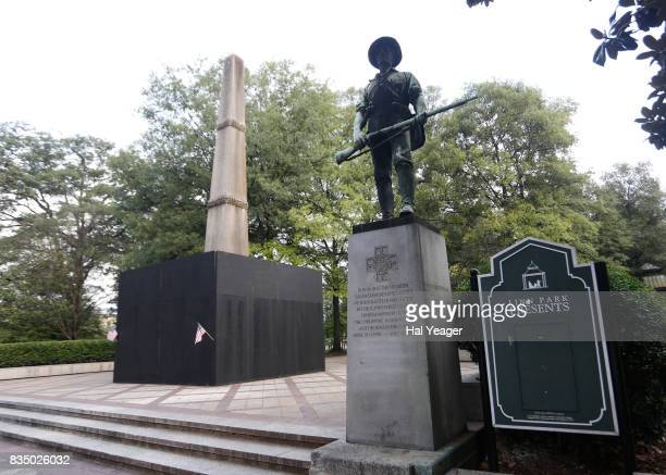 Monument to volunteers of the Army of the Republic stands next to a confederate monument covered up by the mayor of Birmingham in Linn Park August...