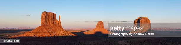monument valley at sunset - monument valley tribal park stock photos and pictures