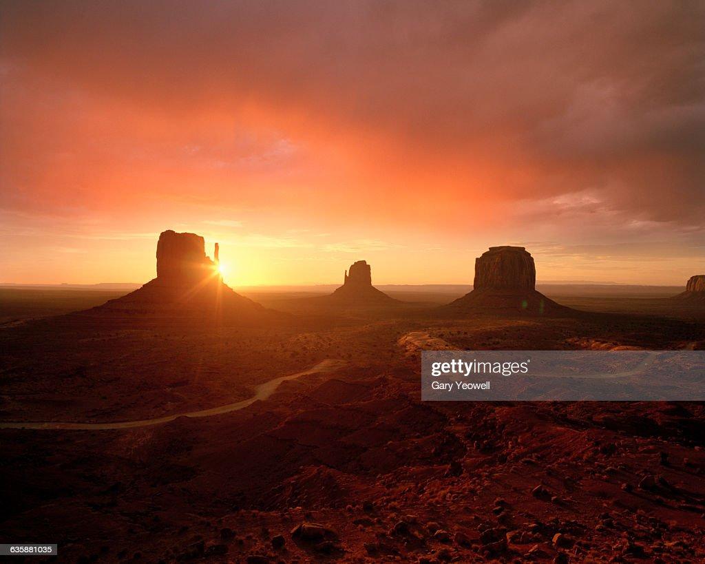 Monument Valley desert landscape at sunset : Stock Photo