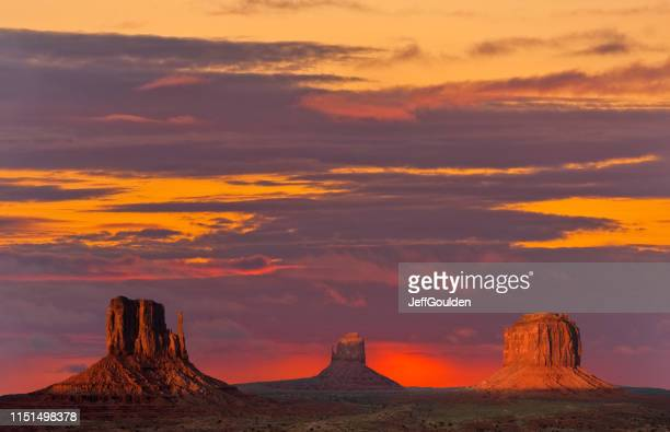 the mittens and merrick butte at sunset - jeff goulden stock pictures, royalty-free photos & images
