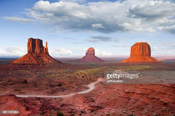 the mittens and merrick butte at sunset - monument valley tribal park stock photos and pictures