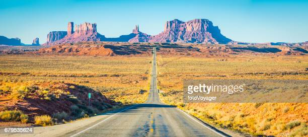 Monument Valley mesas iconic view down desert road panorama Utah