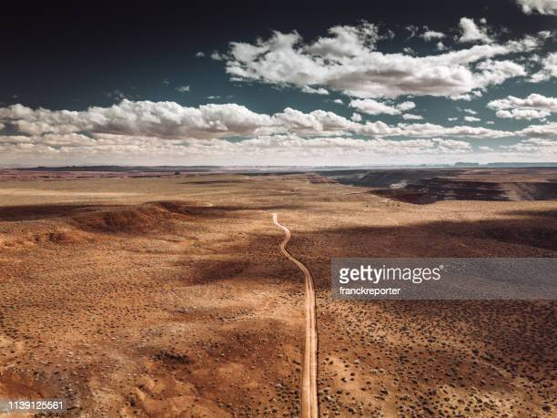 monument valley national park view on the road - sandy utah stock pictures, royalty-free photos & images
