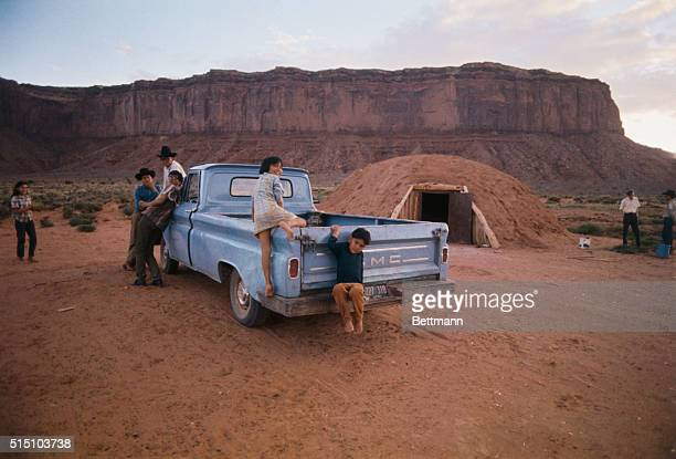 Margurita Jones and her brother Stanley climb into the family pickup truck on Monument Valley Navajo Indian Reservation Many Native American families...