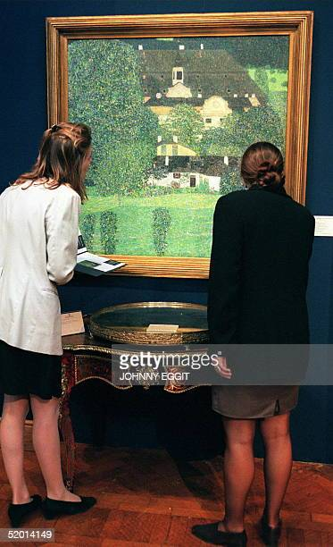 A monumental landscape one of the most significant ever to have appeared at auction by the Viennese artist Kustav Klimt is inspected at Christie's...