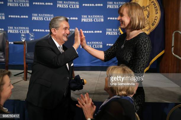 Monumental Sports and Entertainment CEO Ted Leonsis gives a high five to family friend and fivetime Olympic gold medal swimmer Katie Ledecky after...