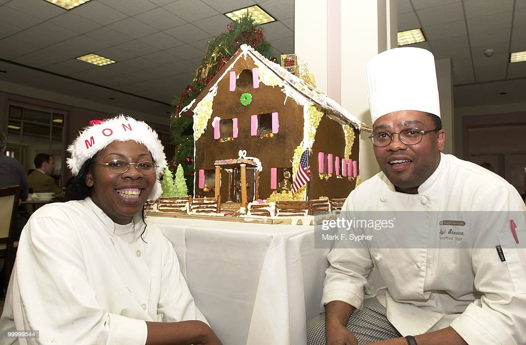 Monya Baldwin, this seasons Rayburn cafeteria decorator, and Nigel Stewart, head chef, show off the giant ginger bread house which Stewart made in the Rayburn cafeteria.