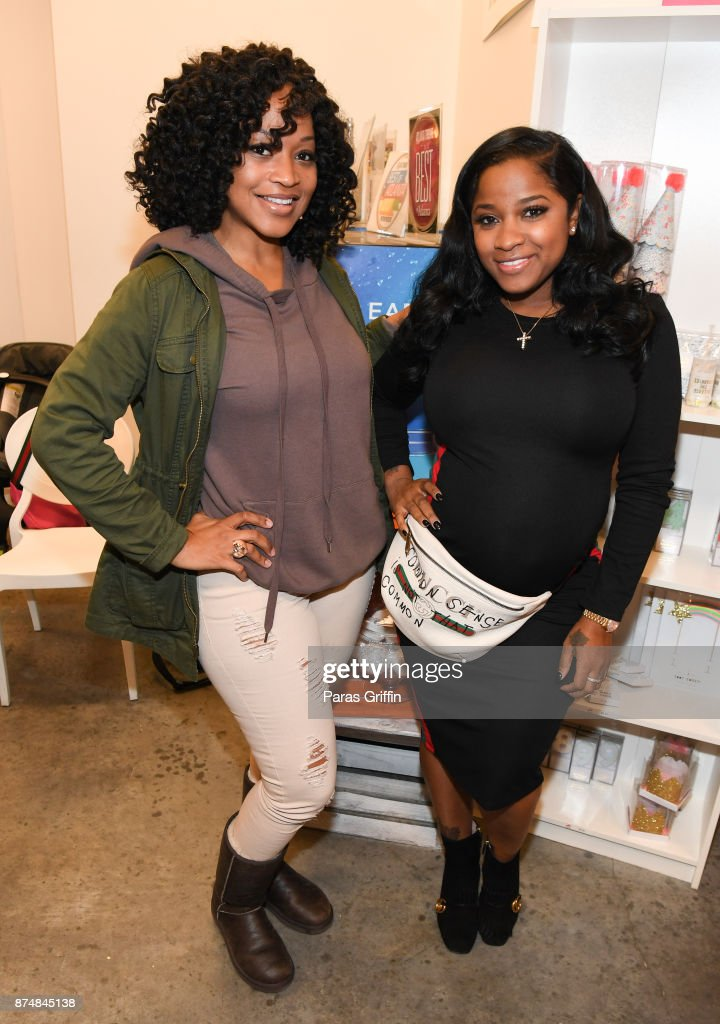 Monyetta Shaw and Toya Wright attend Spreading Ambition Food Drive at CheeseCaked on November 15, 2017 in Atlanta, Georgia.