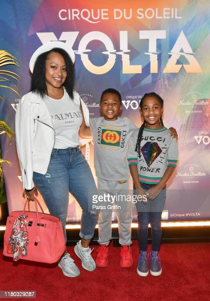 Monyetta Shaw, Mason Evan Smith, and Madeline Grace Smith attend the Atlanta premiere of VOLTA By Cirque du Soleil at Atlantic Station on October 10,...