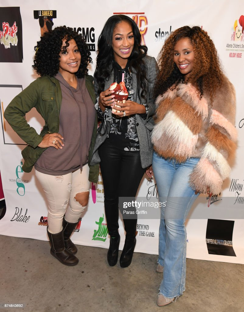 Monyetta Shaw, Niche Caldwell, and guest attend Spreading Ambition Food Drive at CheeseCaked on November 15, 2017 in Atlanta, Georgia.