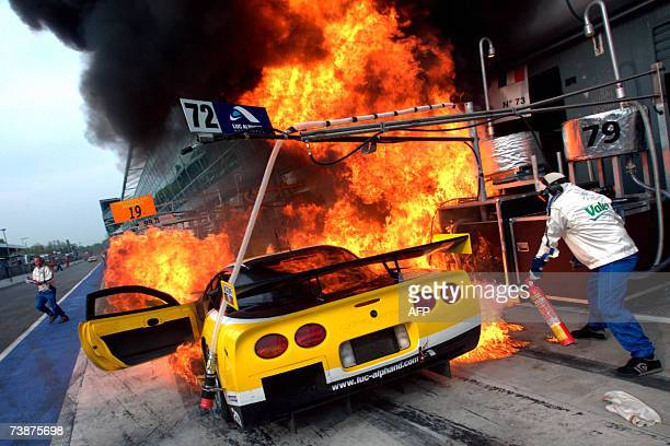 Mechanics attempts to put out the fire in the pits of the Corvette of Belgian driver Vincent Vosse of Luc Alphand Adventures team during the second...