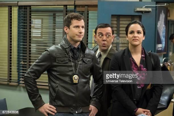 NINE Moo Moo Episode 418 Pictured Andy Samberg as Jake Peralta Joe Lo Truglio as Charles Boyle Melissa Fumero as Amy Santiago