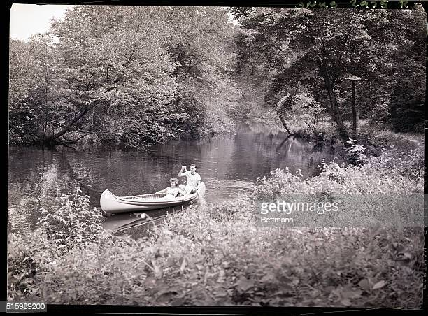 Margaret Buinydas and Jas J Woods Jr find a secluded spot in their canoe on the Salmon River Photo circa 1950