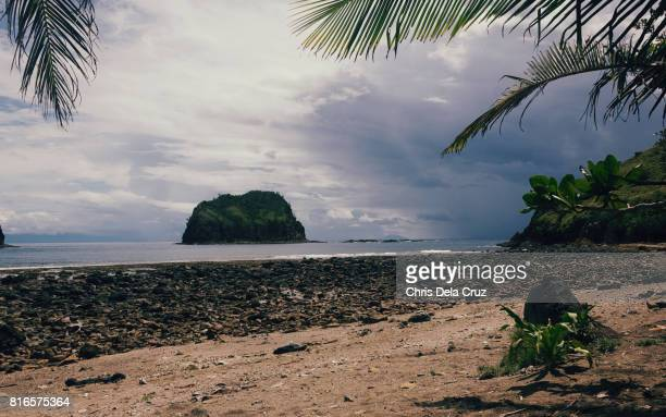 Moody beach with islet