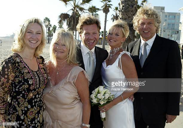 Moody Blues bassist John Lodge poses with his new daughter in law Elizabeth Baldwin who married his son Kristian Lodge Kirsten Lodge and Emily Lodge...