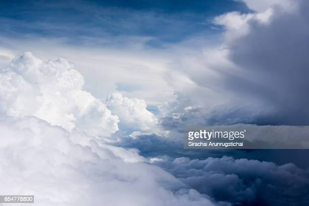Moody cumulus clouds over the sky during flight