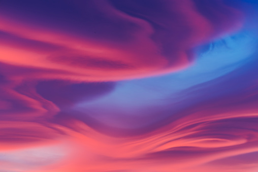 Moody lenticular clouds at sunset - gettyimageskorea