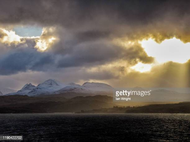 moody light across loch gairloch - moment of silence stock pictures, royalty-free photos & images