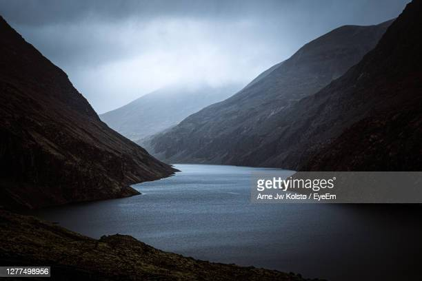 moody mountain landscape in norway - arne jw kolstø stock pictures, royalty-free photos & images