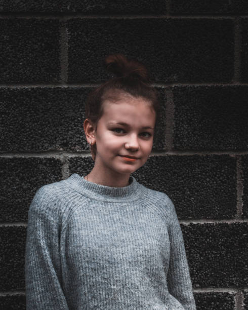 Moody Portrait With Girl In Warm Clothing.
