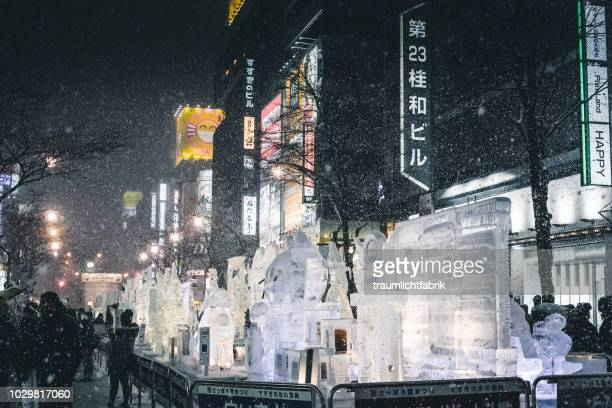 moody sapporo under heavy snowfall - sapporo snow festival stock photos and pictures