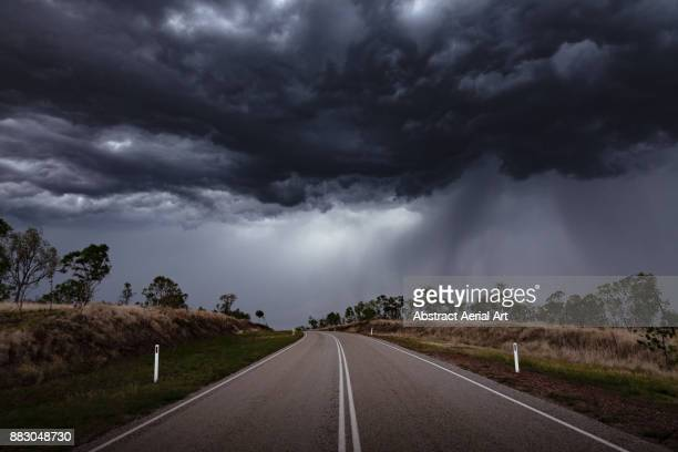 moody skies await - storm cloud stock pictures, royalty-free photos & images