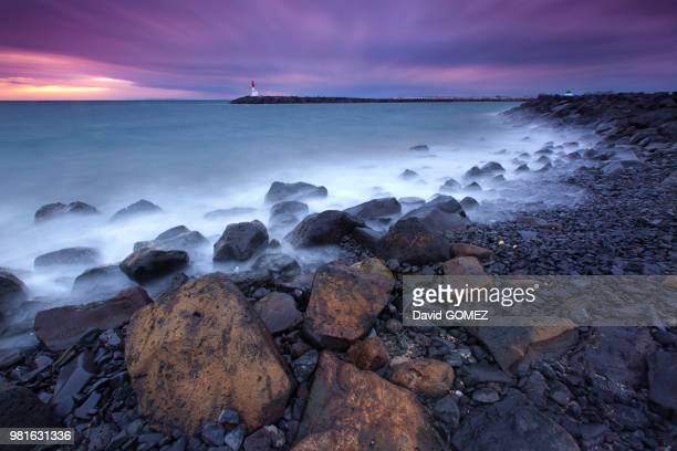 moody sky above coastline at dusk, cap d'agde, agde, france - cap dagde stock pictures, royalty-free photos & images