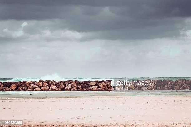 moody sky above mediterranean sea - 防波堤 ストックフォトと画像