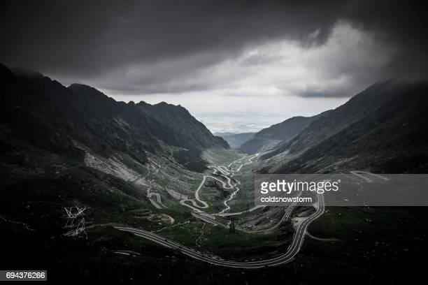 moody sky and mountain landscape at transfagarasan road, transylvania, romania - transylvania stock pictures, royalty-free photos & images